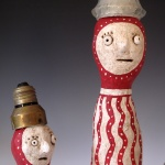 A detailed view of paper mache crazy characters.